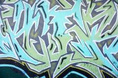 Bunte Graffiti auf einer Backsteinmauer Stockbilder