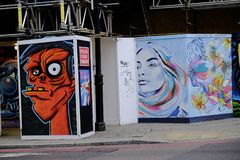 Bunte Graffiti in London Großbritannien Stockfotos