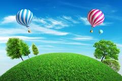 Bunte Heißluft steigt mit einem Sommerhintergrund im Ballon auf Lizenzfreies Stockfoto
