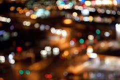Bunte helle Lichter auf dunklem Nachthintergrund Lizenzfreie Stockfotos