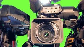 Bunte helle Stellen auf drei Kameraobjektiven stock video