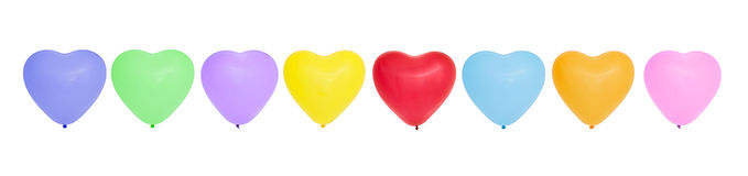 Bunte Herz-förmige Ballone in Folge stockfotografie