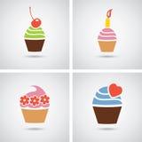 Bunte Ikonen der kleinen Kuchen Lizenzfreie Stockbilder