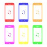 Bunte intelligente Telefone, die Musik spielen Stockfoto