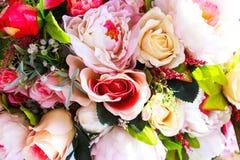 Bunte künstliche Blumen Beschaffenheit, Hintergrund Stockbild