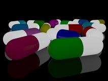 Bunte Kapseln von Medizin auf einem schwarzen Hintergrund lizenzfreie abbildung
