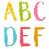 Bunte Karikaturvektorbuchstaben mit Beschaffenheit Lizenzfreies Stockbild