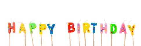 Bunte Kerzen in den Buchstaben, die alles Gute zum Geburtstag sagen, lizenzfreie stockbilder