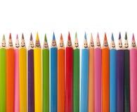 Bunte lächelnde Bleistifte Stockbild