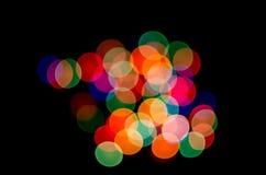 Bunte Lichter des schwarzen Hintergrundes Stockfotografie