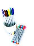 Bunte magische Stifte auf weißem Hintergrund Stockfotografie