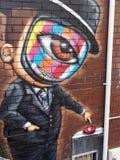 Bunte Mann-Graffiti gemalt auf Backsteinmauer Lizenzfreie Stockfotografie