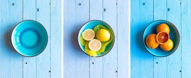 Bunte orange Früchte über einer hellblauen gemalten hölzernen Tabelle Lizenzfreie Stockbilder