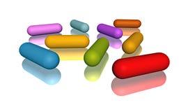 Bunte Pillen auf reflektierender Oberfläche Stockfoto