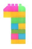 Bunte Plastikblöcke, die das Nummer Eins bilden Stockfotos