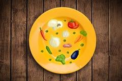 Bunte Platte mit Hand gezeichneten Ikonen, Symbolen, Gemüse und Franc Stockfotografie