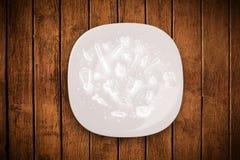 Bunte Platte mit Hand gezeichneten Ikonen, Symbolen, Gemüse und Franc Stockfoto
