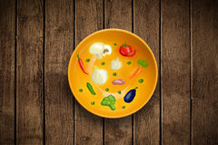 Bunte Platte mit Hand gezeichneten Ikonen, Symbolen, Gemüse und Franc Lizenzfreies Stockbild