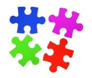 Bunte Puzzlespielnahaufnahme lokalisiert auf Weiß Stockbilder