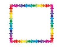 Bunte Regenbogenpuzzlespielstücke, die einen Rahmen bilden Lizenzfreie Stockfotos