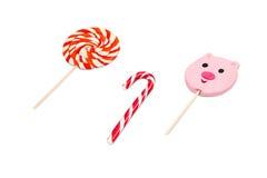 Bunte Süßigkeiten auf weißem Hintergrund Stockfotografie