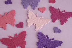 Bunte Schmetterlinge auf Purpur Stockfotografie