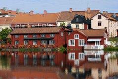 Bunte skandinavische Häuser Stockbilder