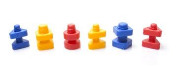 Bunte Spielzeugmuttern - und - Schrauben Lizenzfreies Stockfoto