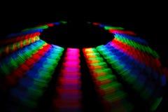 Bunte Spur, die LED in der Form einer Platte dreht Stockfotografie