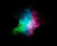 Bunte Staub-Partikel-Explosion lokalisiert auf schwarzem Hintergrund Lizenzfreie Stockbilder