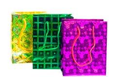 Bunte Taschen mit ganz eigenhändig geschriebem Muster für Geschenke Stockfotografie