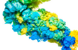 Bunte Tinte im Wasser lokalisiert auf Weiß Abstrakter Acrylhintergrund Farbfarbenflüssigkeit Lizenzfreie Stockfotografie