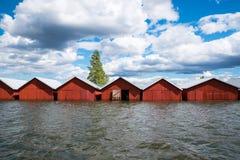 Bunte traditionelle Bootshäuser in Kerimäki, Finnland stockfoto