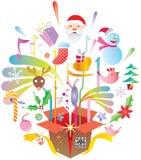 Bunte Weihnachtselemente aus dem Kasten heraus Stockfotografie