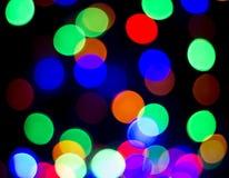 Bunte Weihnachtszusammenfassungs-Hintergrundlichter Stockbild