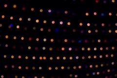 Bunte Weihnachtszusammenfassungs-Hintergrundlichter Stockbilder