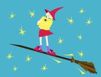 Bunte Zauberin auf dem Besen Stockbild