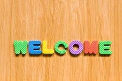 Bunte Zeichen mit dem Willkommen getrennt Lizenzfreie Stockbilder