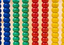 Bunter Abakus für Mathe, das als Hintergrund lernt Stockbild