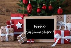 Bunter Baum, Frohe Weihnachten bedeutet frohe Weihnachten Stockfotografie