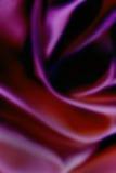 Bunter blured Luxushintergrund gemacht vom silk Stoff mit weichem Licht und curvy Formen und Wellen Zusammenfassung blured buntes Stockbilder