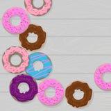 Bunter Donut auf grauem hölzernem Hintergrund stock abbildung