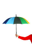 Bunter geöffneter Regenschirm in der Hand auf weißem Hintergrund Stockbilder