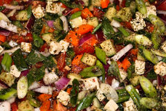 Bunter griechischer Salat-Hintergrund lizenzfreie stockfotografie
