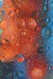 Bunter Hintergrund mit Blasen in der Orange und in Ble Lizenzfreies Stockfoto