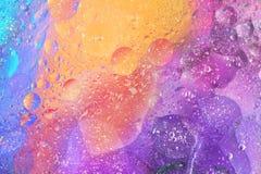 Bunter Hintergrund mit Blasen in purpurrotem Orange und blau Lizenzfreies Stockfoto