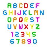 Bunter Origami des Alphabetes und der Zahlen Stockfotografie