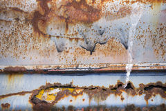 Bunter rostiger Metallkorrosions-Tapetenhintergrund Stockbild