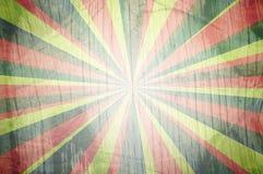 Bunter Sunbeams grunge Hintergrund Lizenzfreie Stockfotografie