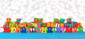 Bunter Text der frohen Weihnachten und varicolored Geschenke Lizenzfreie Stockfotos